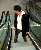 Man on escalator Stock Photo