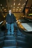 Man in escalator Royalty Free Stock Photos