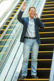 Man on escalator. Royalty Free Stock Image