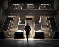 Man in escalators Stock Images