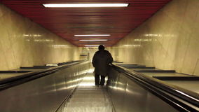 Man on escalators stock video footage