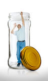 Man Escapes from a Glass Jar Stock Photography