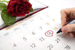 Man escorts date in calendar Royalty Free Stock Photo