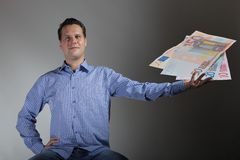 Man with euro banknotes Stock Photo