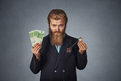 Man with euro cash currency and retro pocket watch royalty free stock photography