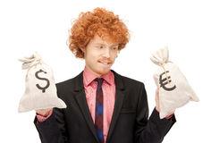 Man with euro and dollar bags. Picture of handsome man with euro and dollar bags royalty free stock photo