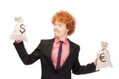 Man with euro and dollar bags Stock Photos