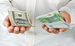 Man with euro and dollars Royalty Free Stock Image