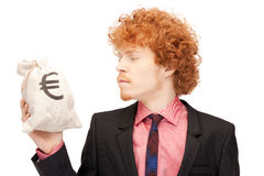 Man with euro signed bag Royalty Free Stock Images