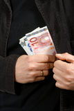 Man with euros in their pockets, close-up Stock Photo