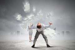 Man evading flying puzzle Stock Photography