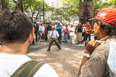 Man evangelical preacher explains God`s Word. Sao Paulo, Brazil, January 09, 2009. Man evangelical preacher explains God`s Word in Se Square in downtown Sao stock photography