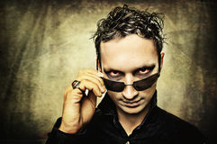 Man with evil eyes and sun glasses. Male demon with evil eyes and sun glasses Royalty Free Stock Image