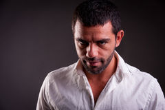 Man with evil look. Looking straight to camera stock photography