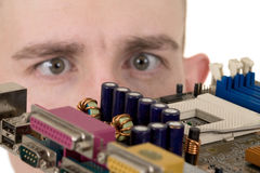 Man examines an electronic circuit Royalty Free Stock Photos