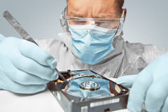 Man examines the hard disk Royalty Free Stock Photos