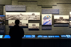 A man examines an information display inside the Zhengyangmen arrow Tower museum, Beijing Stock Images