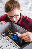 Man examines laptop PC clean dust pollution Stock Images
