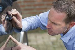 Man examining car royalty free stock photography