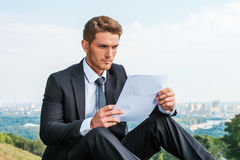 Man examining contract. Royalty Free Stock Photos