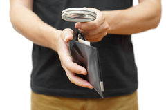 Man examining almost empty  wallet  with magnifying glass Royalty Free Stock Photo