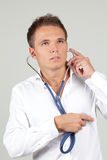 Man examining his own heart Stock Photo