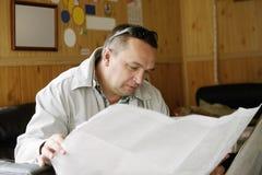 Man examining map Royalty Free Stock Image
