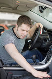 Man examining new car. Royalty Free Stock Images