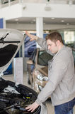 Man examining new car. Royalty Free Stock Image