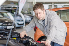 Man examining new car. Royalty Free Stock Photos