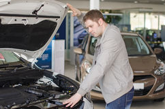 Man examining new car. Stock Photo