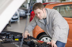 Man examining new car. Stock Photos