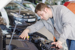 Man examining new car. Stock Photography