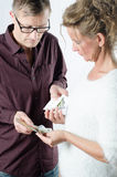 Man is exchanging money against medicine Royalty Free Stock Image