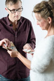 Man is exchanging money against medicine Stock Photography