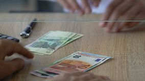 Man exchanging russian rubles for euro in bank, foreign currency market, closeup stock footage
