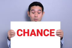 A man with excited face  showing CHANCE sign Stock Photos