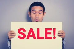 A man with excited face showing SALE! sign Royalty Free Stock Images