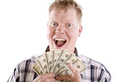 Man excited about money. A blond man with an excited face and a handful of fanned money Royalty Free Stock Image