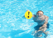 Man with exclamation mark in the pool Stock Images