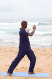 Man exercise. Young african american man doing tai chi exercise on beach Royalty Free Stock Photos