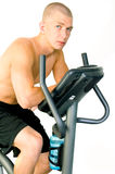 Man on Exercise Bike Stock Photo