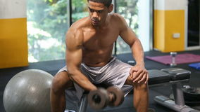 Man exercise with dumbbells in gym stock video footage