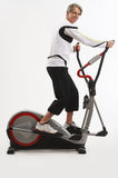 Man on the exercise equipment Royalty Free Stock Images