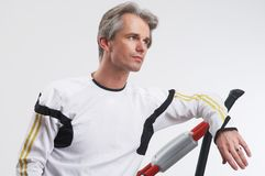 Man and exercise equipment Stock Photos