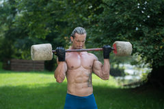 Man Exercise With Made Hand Barbell Outdoors Workout Royalty Free Stock Image