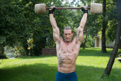 Man Exercise With Made Hand Barbell Outdoors Workout Stock Image