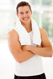 Man after exercise. Smiling young man at the gym with arms folded after exercise Stock Photos