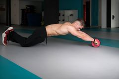 Man Exercise Whit A Ab Roller royalty free stock image