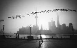 A man exercises on the Bund as the sun rises royalty free stock photography